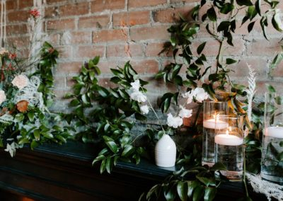 floral and candle arrangement industrial wedding